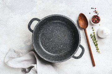 Empty black pan for cooking, spices and herbs. Cooking background, copy space for recipe, design elements or text. Top view