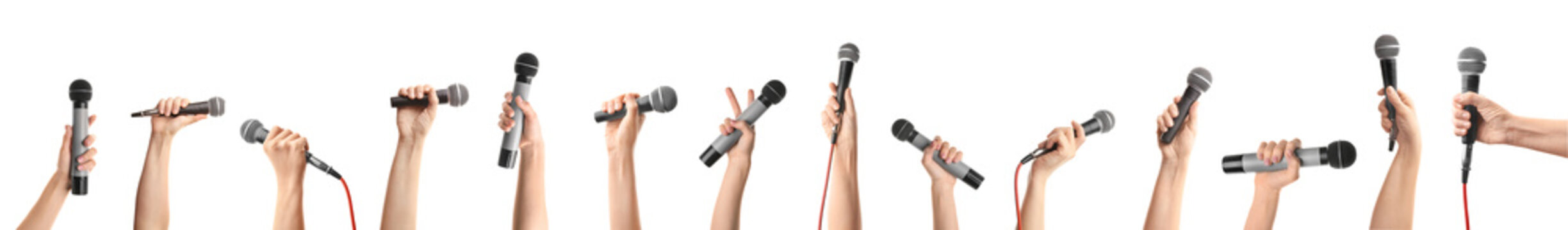 Female hands with microphones on white background