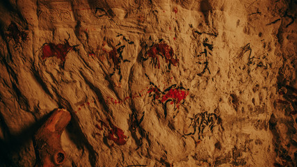 Primitive Prehistoric Neanderthal Drawings of Animals and Abstracts. Bonfire illuminating Walls at Night. First Cave Art Made from Petroglyphs, Rock Paintings.