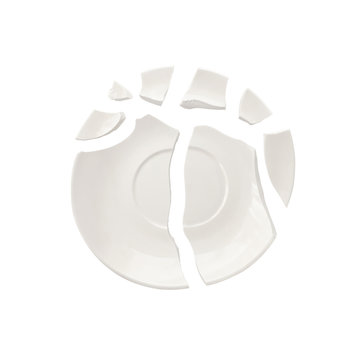 Top view of broken plate isolated on white background. Smashed pieces of dish
