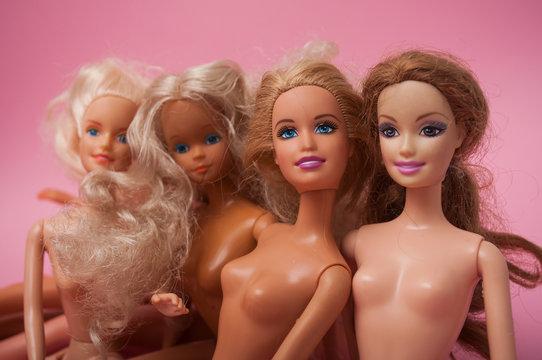 Mulhouse - France - 22 December 2019 - Closeup of Barbie Dolls on pink background