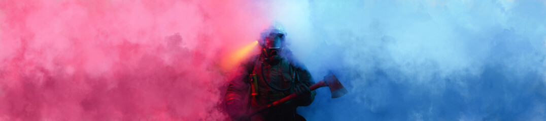 Fireman with axe in the smoke.