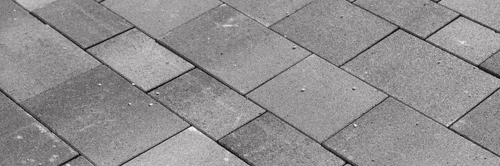 New gray paving stones in the driveway. Gray background Fototapete