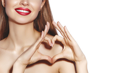 Romantic young Woman making Heart Shape with her Fingers. Love and Valentines Day Symbol. Fashion girl with Happy Smile Fotomurales