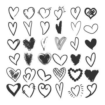 Heart symbol set sketch engraving vector illustration. Romantic love lovesickness symbol. T-shirt apparel print design. Scratch board imitation. Black and white hand drawn image.