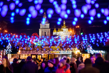 Festive Christmas illuminations and Saint Michael Golden Domed Cathedral in Kyiv, Ukraine. December 2019