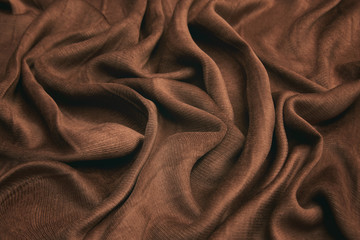 Luxurious velvet fabric in cocoa color. Background and pattern.