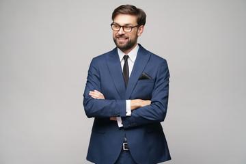 studio photo of young handsome businessman wearing suit Fotobehang