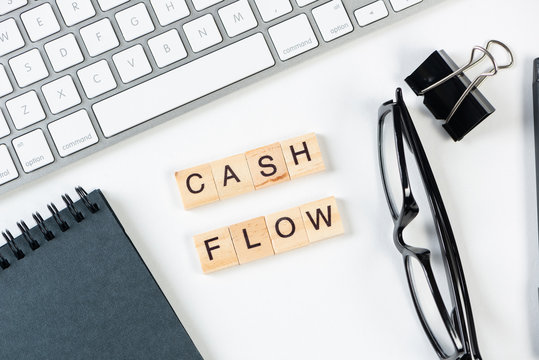 Cash flow statement concept with letters on cubes