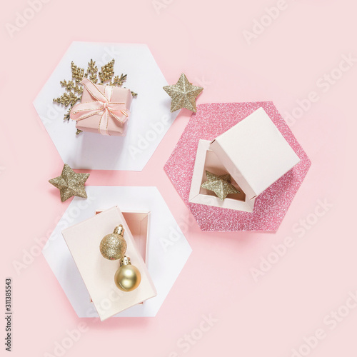Festive pink flat lay. Set of gift boxes on white hexagons hexagons on a pink background, birthday, wedding day, mother's day, valentines day, greeting card