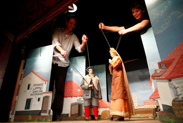 Geal manipulates puppets of Christmas nativity show at the Royal Toone Theatre in central Brussels