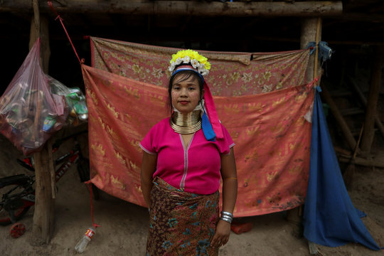 An ethnic Kayan hill tribe refugee woman, also known as long neck woman, poses at her tourist attraction village near Chiang Mai