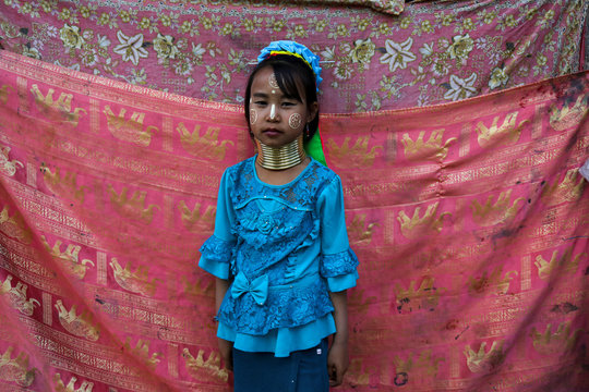 An ethnic Kayan hill tribe refugee girl, also known as long neck woman, poses at her tourist attraction village near Chiang Mai