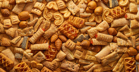 Top view of a variety of cookies Texture (background) of the cookie in the studio Cookies wallpaper background Backgrounds and textures: group of various cookies Concept of food and pastry products. Fototapete