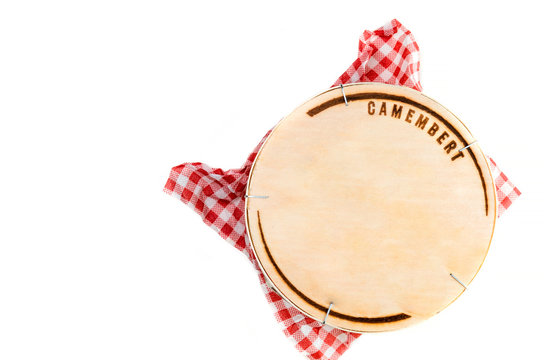 Wooden box with camembert cheese on white background - top view