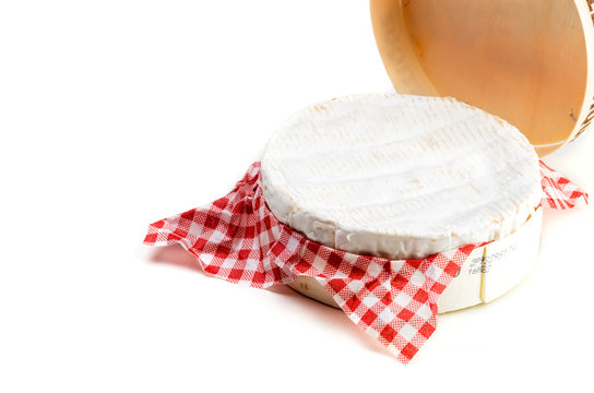 Camembert cheese in wooden box on white background - close up