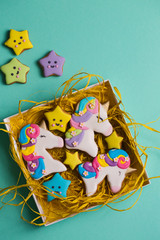 unicorn shaped cookies in a gift box