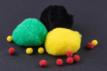 pompoms different sizes and colors