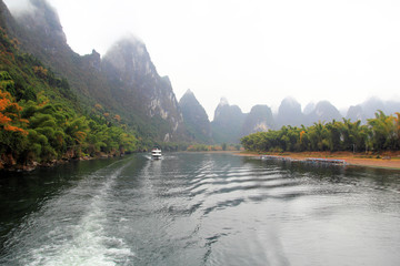 Cruise ship travels the route along the Li river from Guilin to Yangshou,China