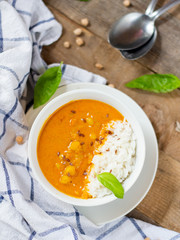 Chickpea Curry in white bowl on wooden table