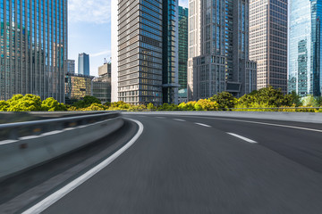 Fotomurales - empty road with modern buildings on background, shanghai, china..