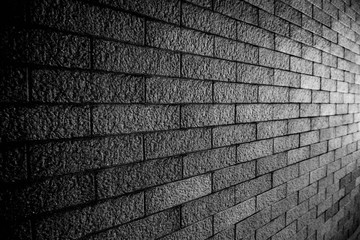 Dark brick wall texture background Masonry or stone flooring in the old style of stone. Black brick...