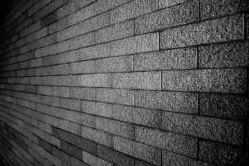 Dark brick wall texture background Masonry or stone flooring in the old style of stone. Black brick wall texture, brick texture for background, vintage dark gray bricks