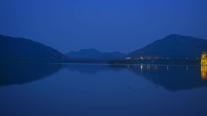Wall Mural - Jal Mahal Water Palace illuminated at night in Jaipur. Rajasthan, India. Horizontal pan