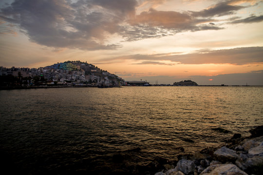 Kusadasi, Turkey - September 17, 2019: View of the coast of Kusadasi, Turkey. Sunset over the port in the tourist town.