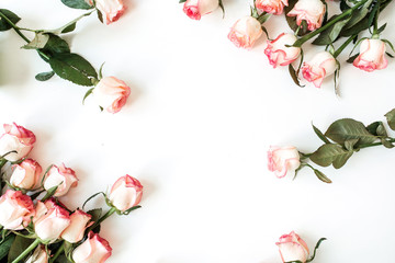 Round frame border of pink rose flowers on white background. Mockup blank copy space. Flat lay, top view floral composition.