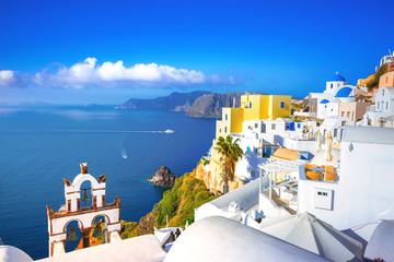 Fototapeten Santorini Oia town on Santorini island, Greece. Traditional and famous houses and churches with blue domes over the Caldera, Aegean sea