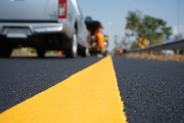 Yellow traffic paint lines during construction phase, blurred pictures