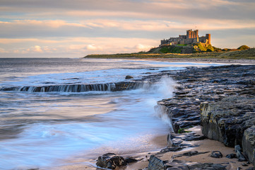 Bamburgh Beach below the Castle, and dunes which are dominated by the imposing medieval castle and located within Northumberland Coast Area of Outstanding Natural Beauty