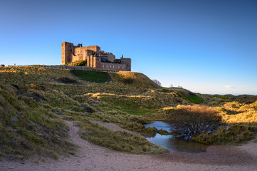Bamburgh Beach Floodwater in the Dunes, which are dominated by the imposing medieval castle and located within Northumberland Coast Area of Outstanding Natural Beauty