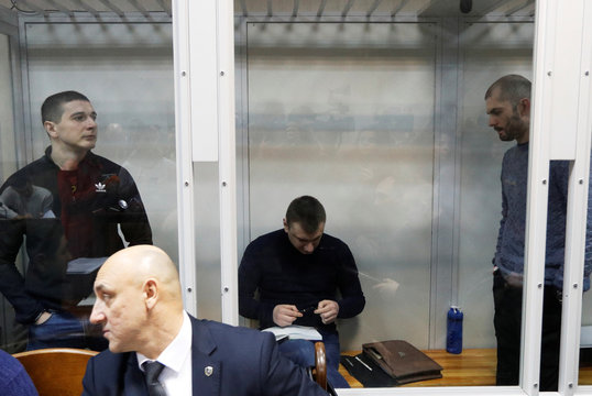 Former members of the Berkutriot police unit attend a court hearing in Kiev