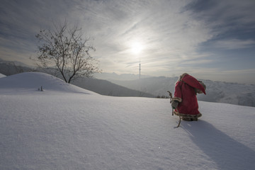 Photo sur Toile Gris Santa Claus on a snowy mountain winter landscape
