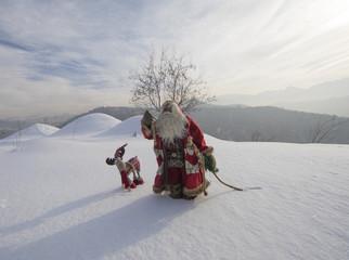 Foto op Canvas Donkergrijs Santa Claus on a snowy mountain winter landscape