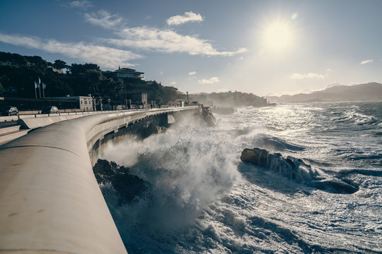 Stormy day with the wind and the big waves breaking on Corniche Kennedy in Marseille city