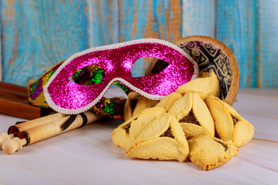 Hamantaschen cookies hamans ears, Purim celebration mask and noisemaker