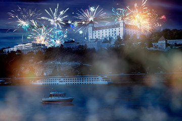 celebrate abstract holidays in bratislava, slovakia, europe. christmas or new year fireworks at night. composite imagery