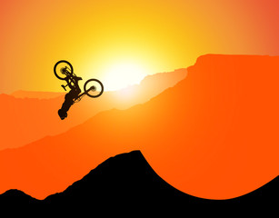 Foto auf Acrylglas Rot MTB / Mountain bike Downhill Backflip in the Mountains, landscape with the setting sun behind the mountains. (without spokes at the wheels, rims)