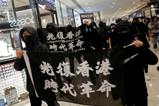 Anti-government protesters march at a shopping mall on Christmas Eve at Tsim Sha Tsui in Hong Kong