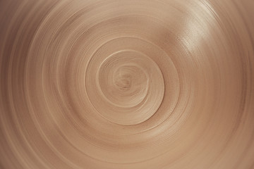 Photo sur Plexiglas Spirale view of spiral lines of raw clay in the ceramic plate, abstract background of infinity with copy space