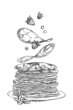 Pancakes and berries falling on the stack