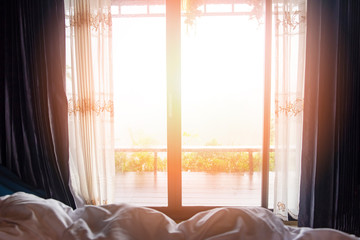 window view nature green mountain in the bed at bedroom morning and sunlight - window glass with drapery Fotomurales