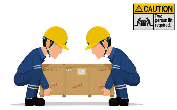 Two workers is lifting the heavy wooden crate