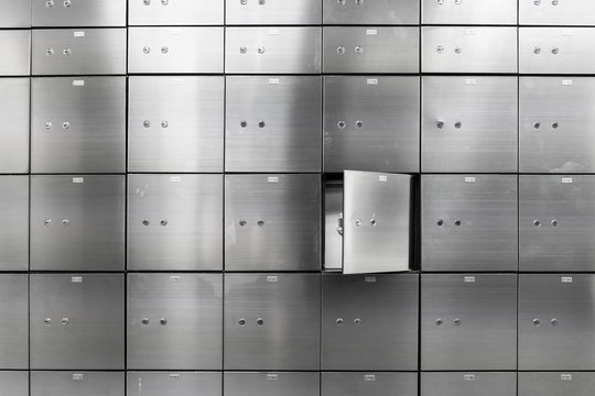 Metal safe box panel wall with open one. Concept for sucurity and banking protection.
