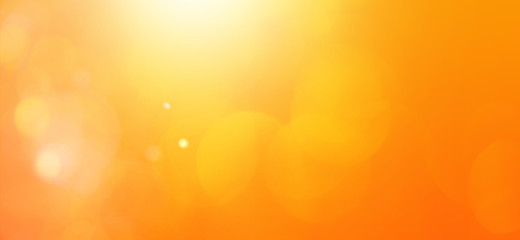 abstract orange background with  bokeh lights and sunlight, panoramic background Fotomurales