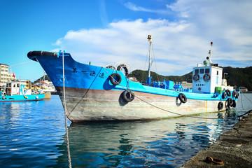 Wall Murals Shipwreck Wakayama, Japan - November 22, 2019: Local fisherman ship at Katsuura fyshing port, traditional wooden boat