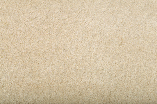 Carpet covering background. Pattern and texture of beige carpet. Copy space.